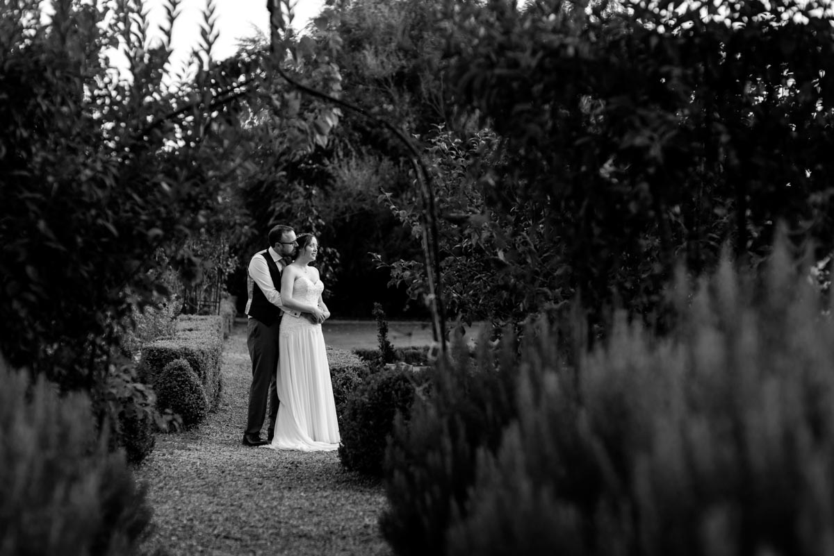 Blacka nd white couple photograph of sarah and chris on their wedding day at the secret garden in kent
