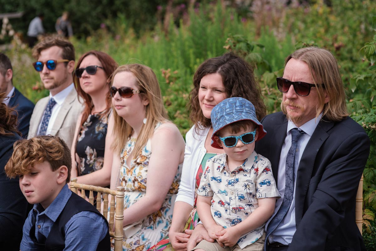 Photograph of wedding guests in their sunglasses at The Secret garden in Kent