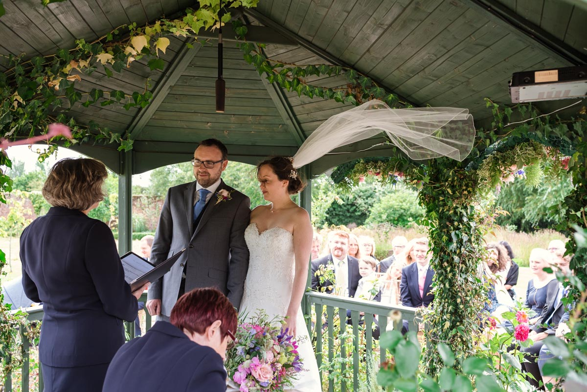 Photograph of wedding ceremony in gazebo at The Secret garden