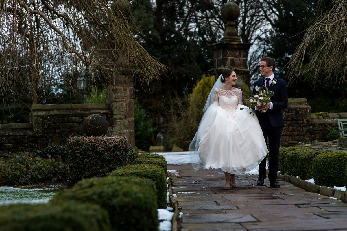 Photograph of Katherine and Tom in Holdsworth House gardens on their wedding day