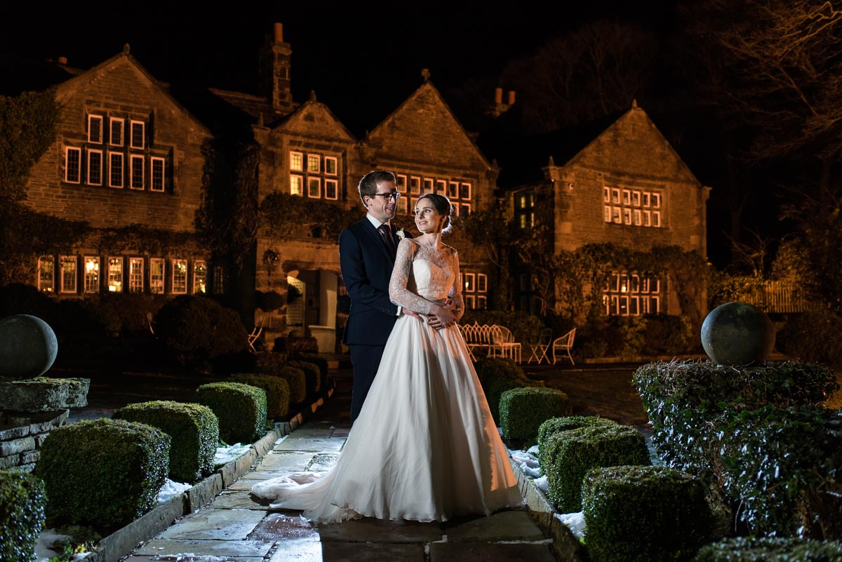Night time wedding portrait of Katherine and Tom at Holdsworth House in Yorkshire