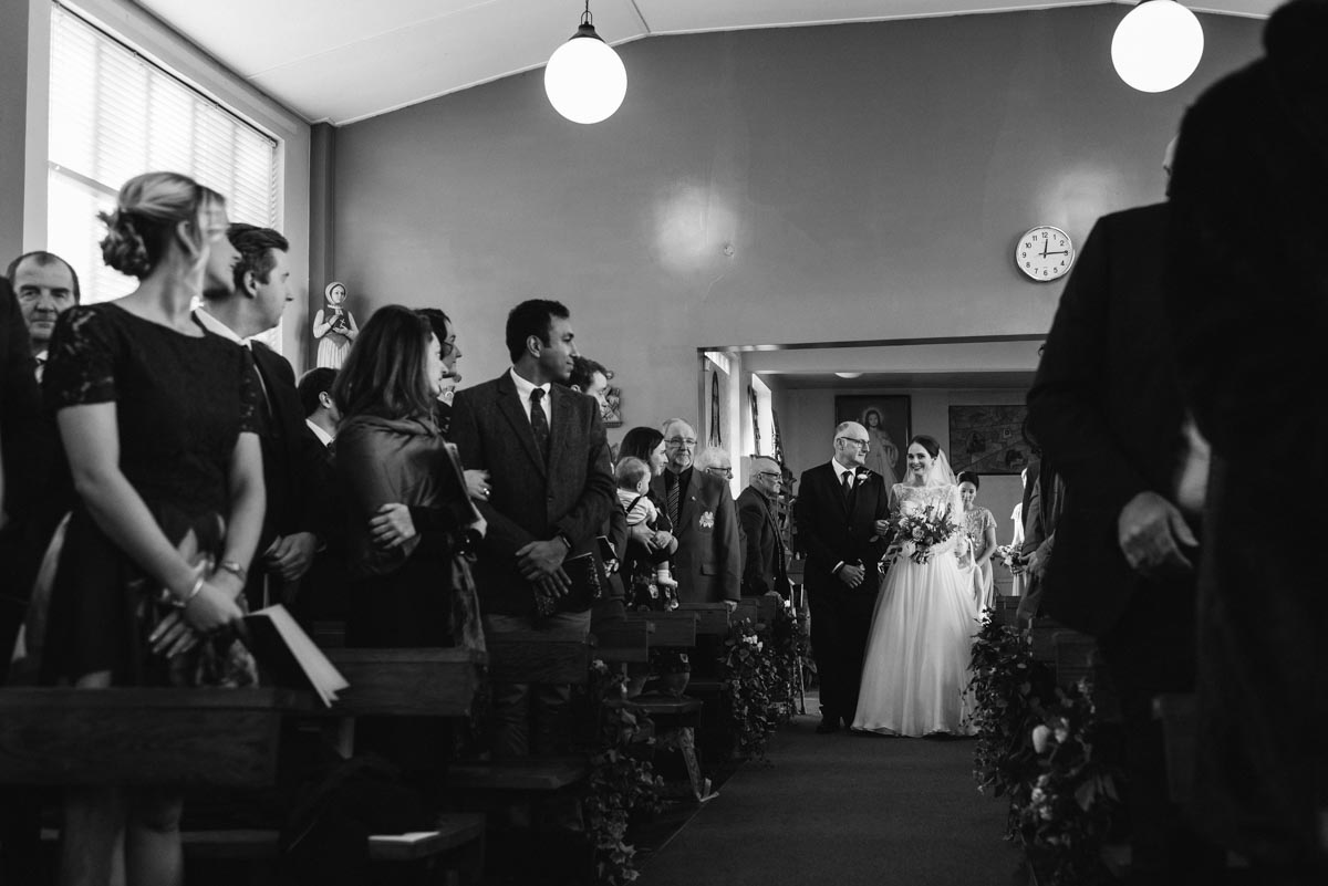 Katherine and her dad walk down the aisle during her Yorkshire church wedding