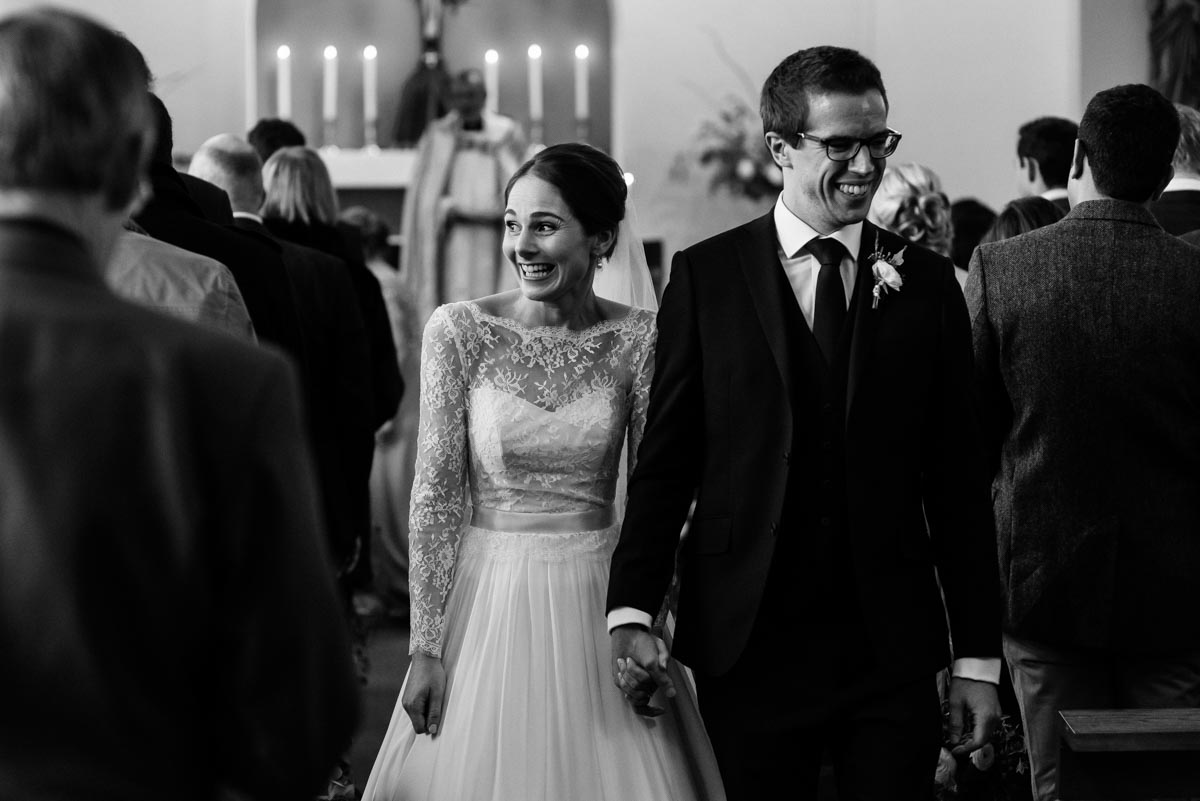 Katherine and Tom walk down the aisle after their church wedding in Yorkshire