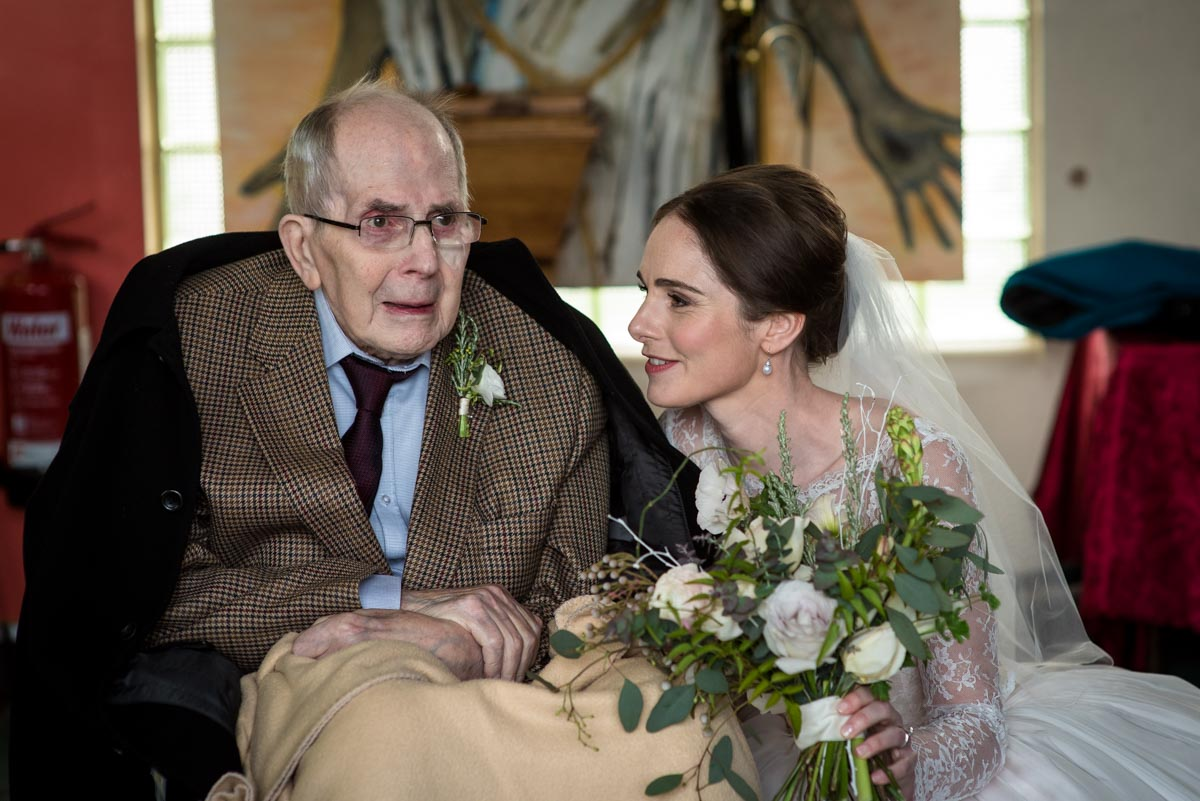 Photograph of Katherine and her grandad on her wedding day in Halifax