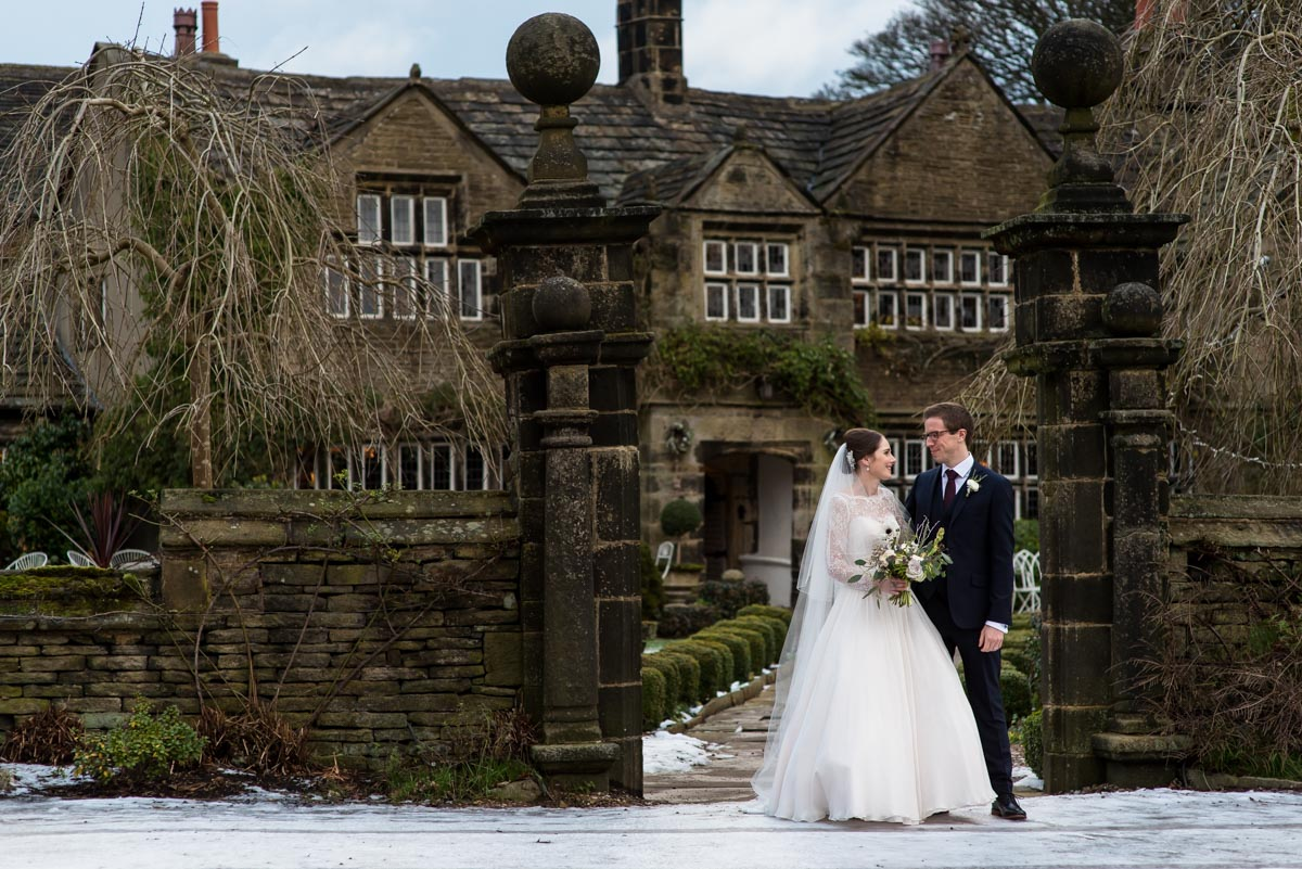 Holdsworth House wedding photography. Katherine and Tom standing at the front of the house.