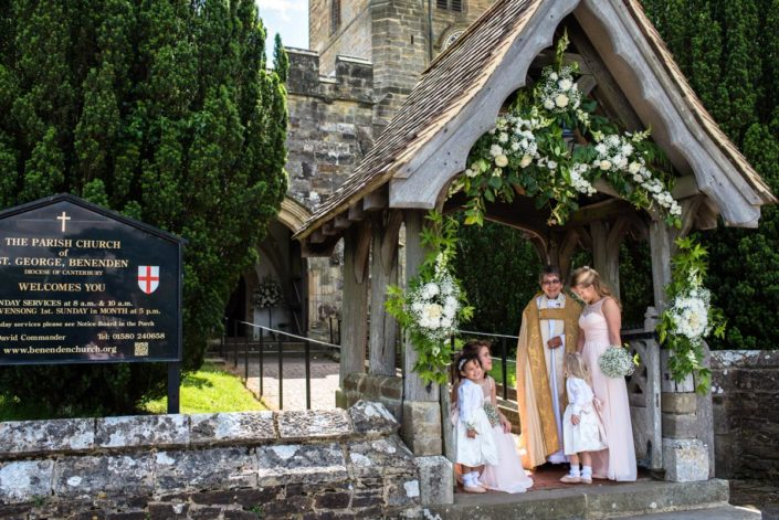 Photograph of flowers over church archway at Benenden Church on wedding day