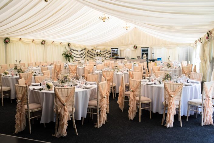 Wedding tables inside marquee at Allington Castle in Kent