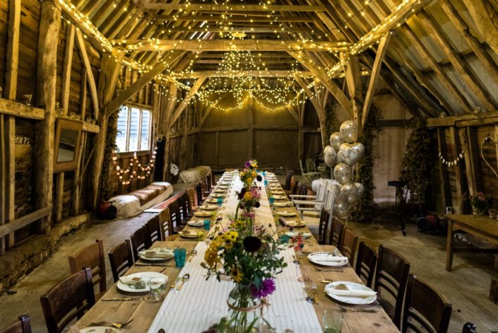 Fairy lights and garden flowers decorate Kent barn for wedding