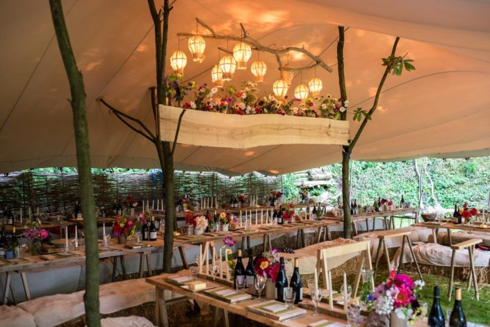 Natural and organic wedding marquee decorations at woodland reception