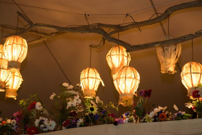 Paper lanterns decorate wedding marquee