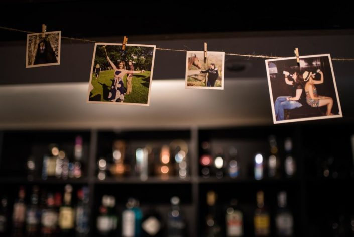 Photos pegged up at wedding reception