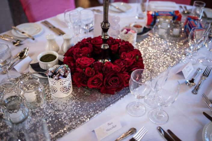 Ring of red roses as wedding table centre piece