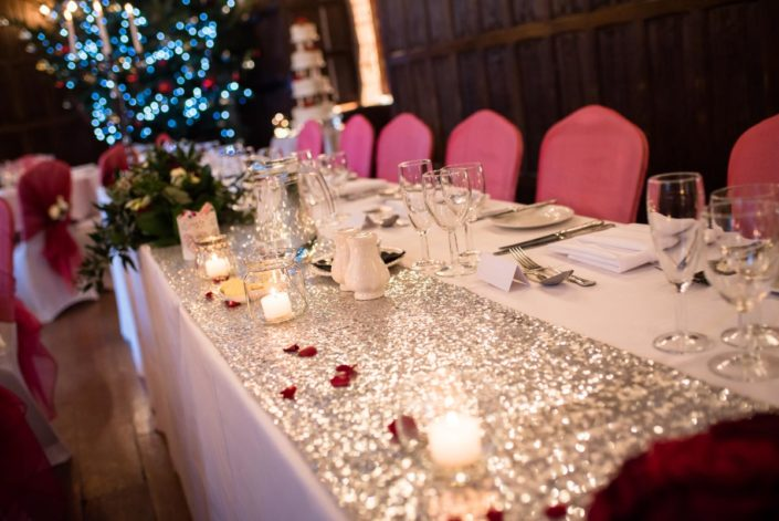 Sparkly festive table runner at Christmas wedding at Lympne Castle