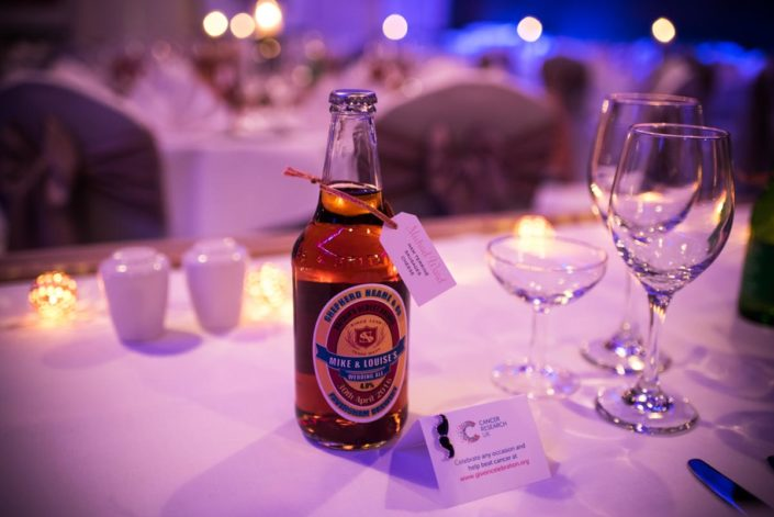 Bottles of beer as table favours at The Shepherd Name wedding venue in Kent