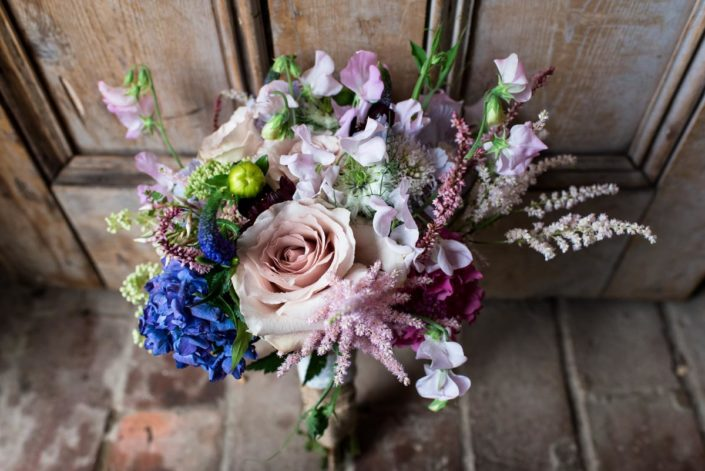 Summer colourful wedding bouquet in blues, mauves and whites
