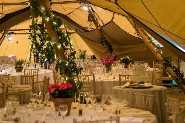 Photograph of wedding tables inside tipis
