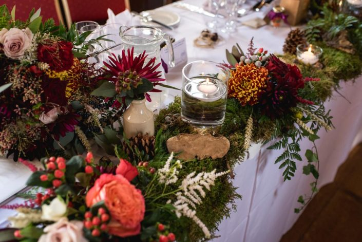 Rich autumn coloured table decorations at Lympne Castle