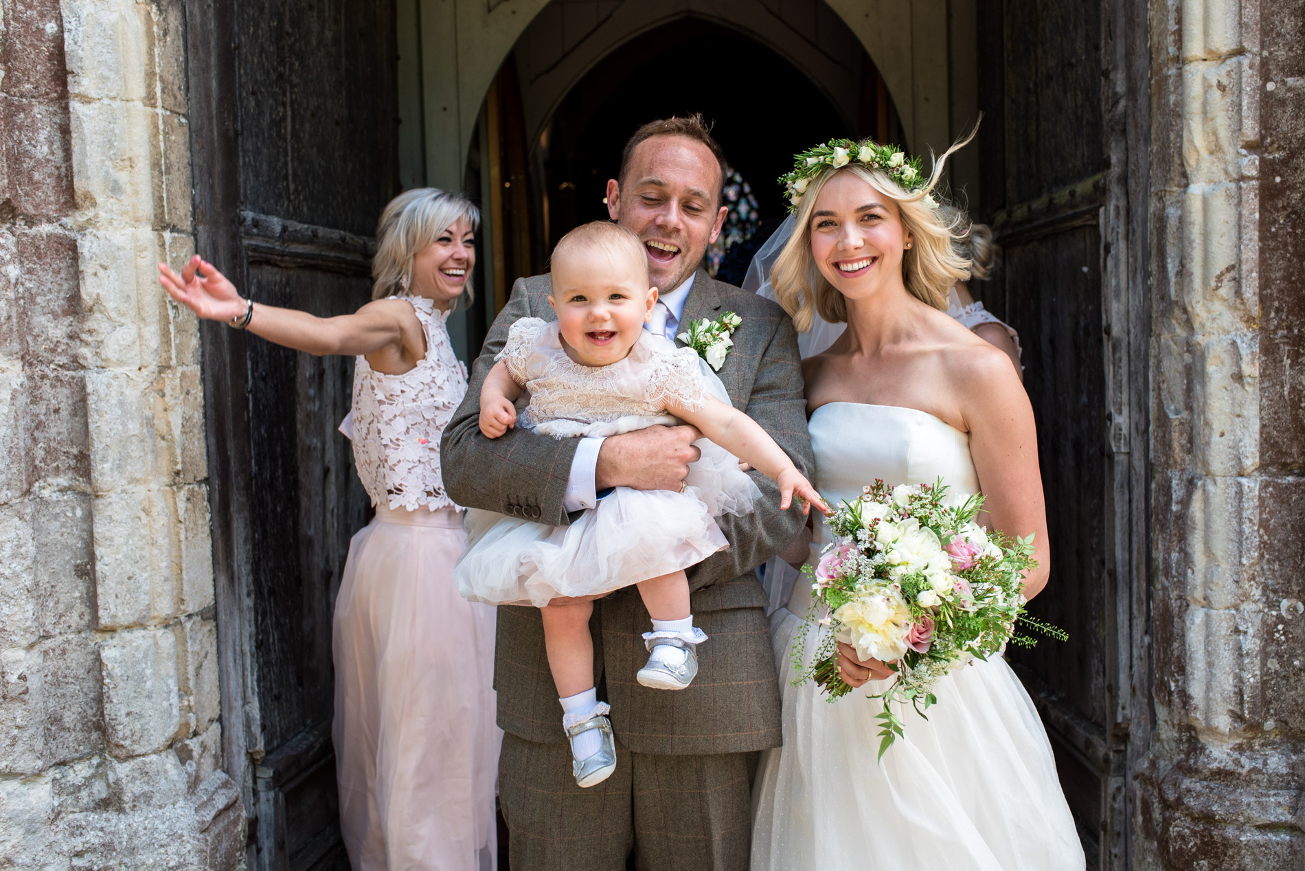Anne and Josh exit the church after their Kent wedding in Chilham