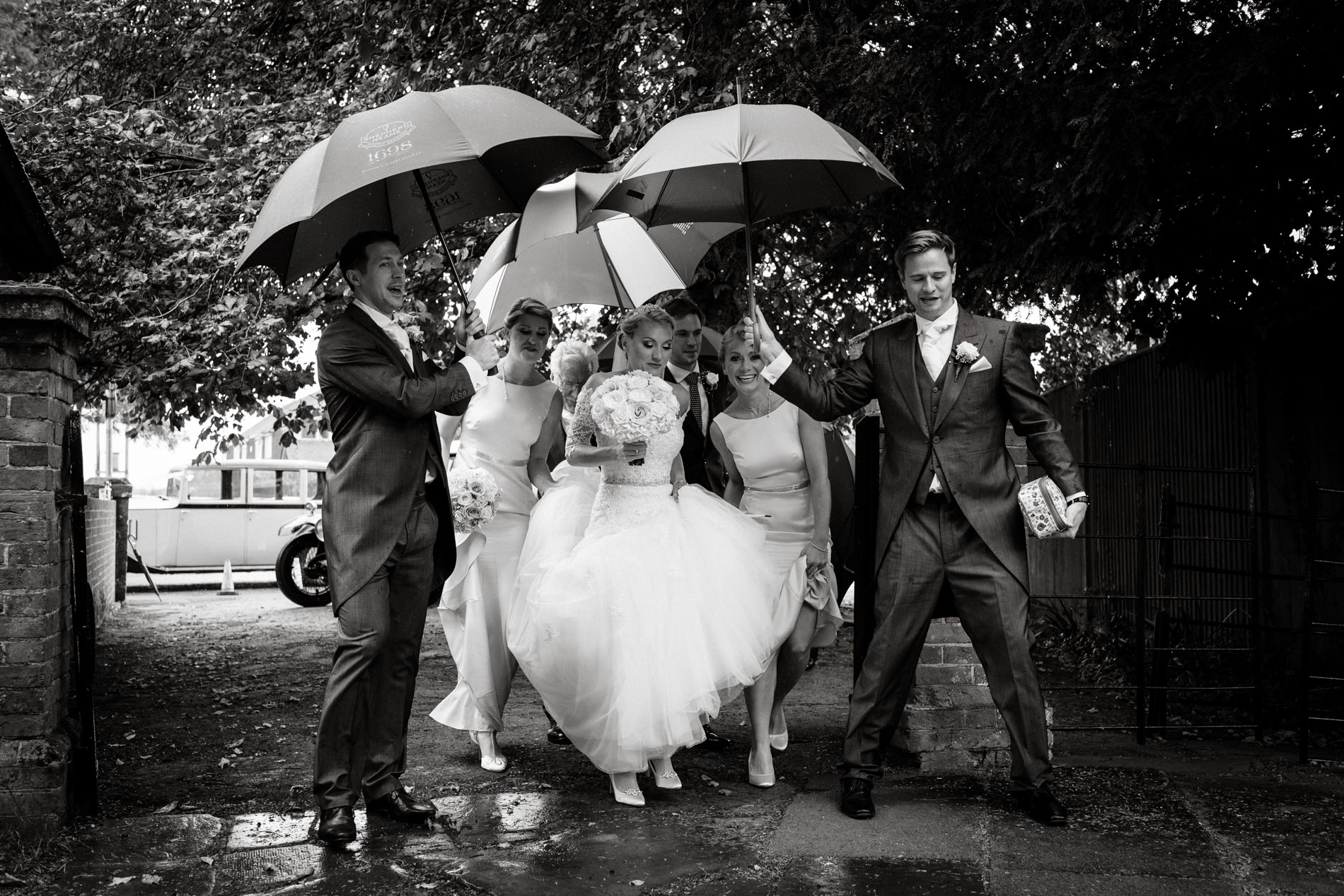 Smarden Church Kent wedding. Rainy day wedding photography