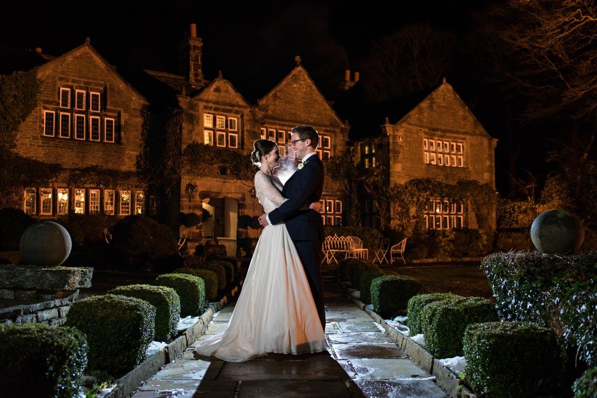 Photograph by Kent wedding photographer Helen Batt of Katehrine & Tom outside Holdsworth House