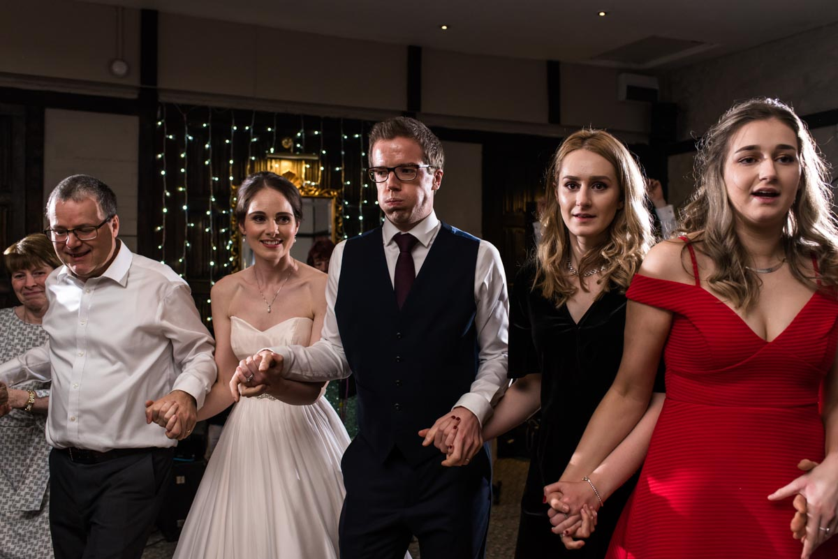 Kent wedding photographer Helen Batt photographs wedding ceilidh at Holdsworth House
