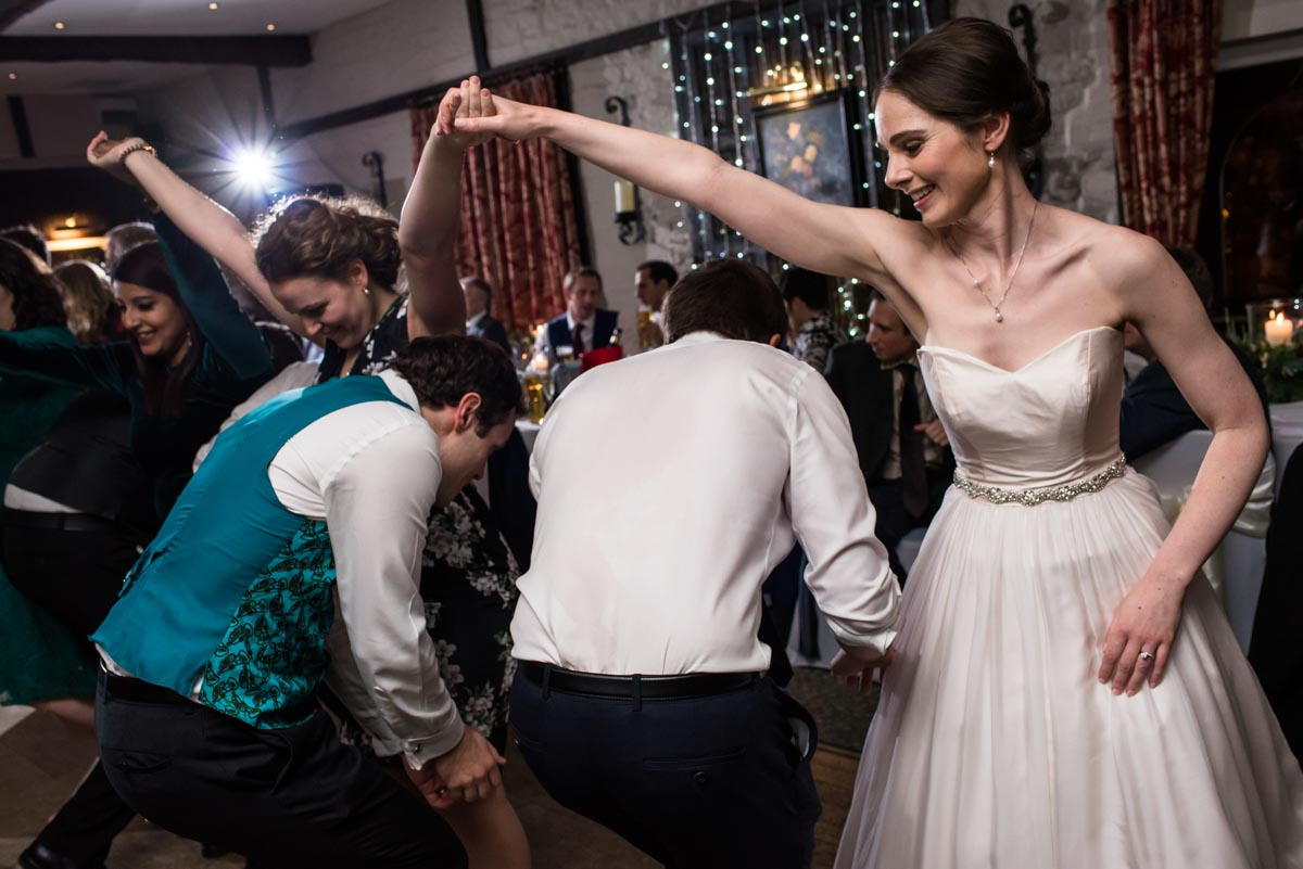 Ceilidh dancing photographed by Kent wedding photographer in Yorkshire wedding venue, Holdsworth House