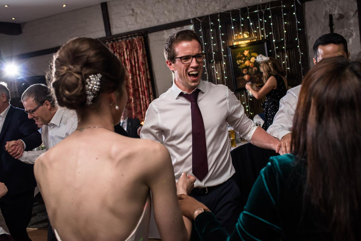 Tom is photographed dancing during his wedding reception