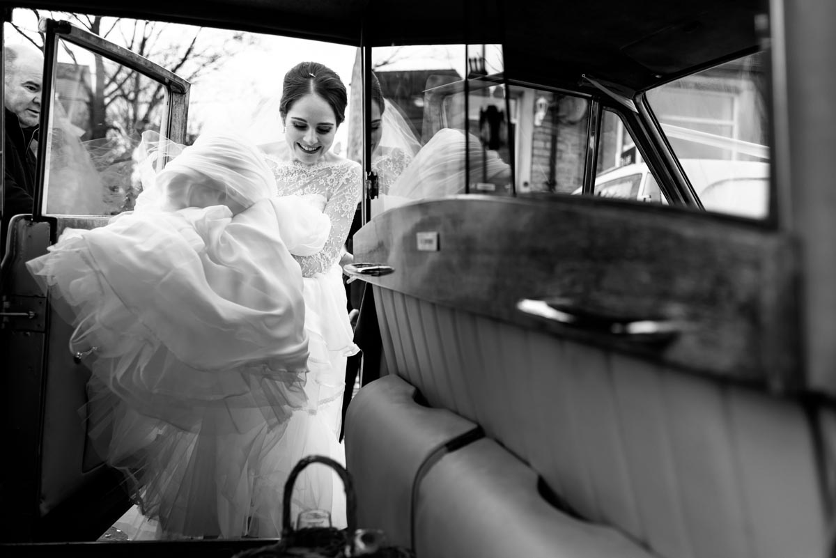 Photograph of Katehrine getting into wedding car