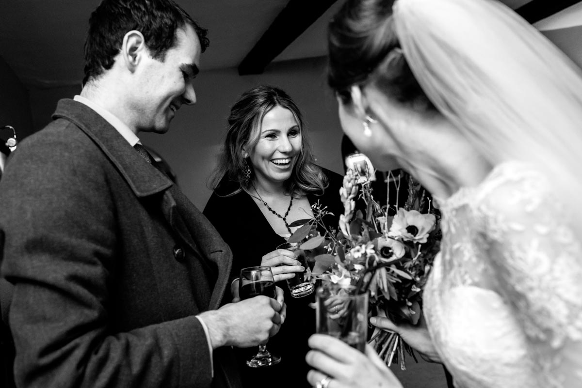 Wedding reception at Holdsworth House, guests greet Katehrine