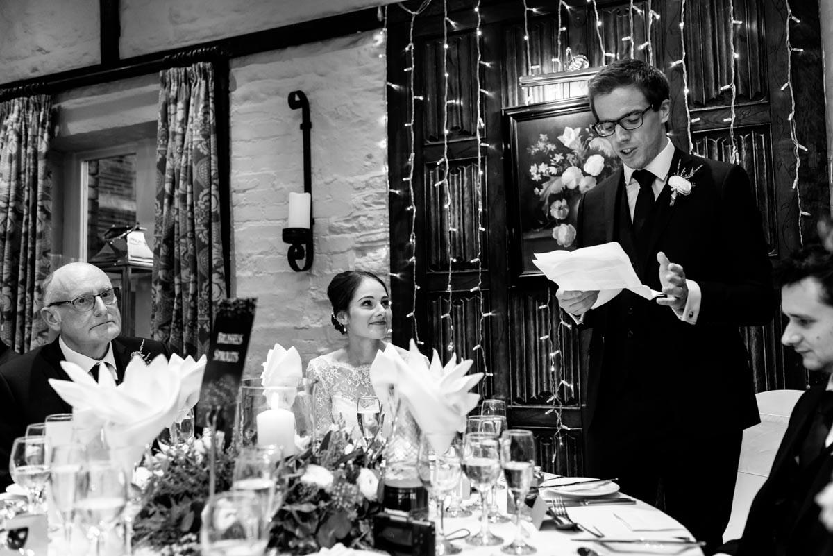 Kent wedding photographer, Helen batt photographs Tom during his wedding speech
