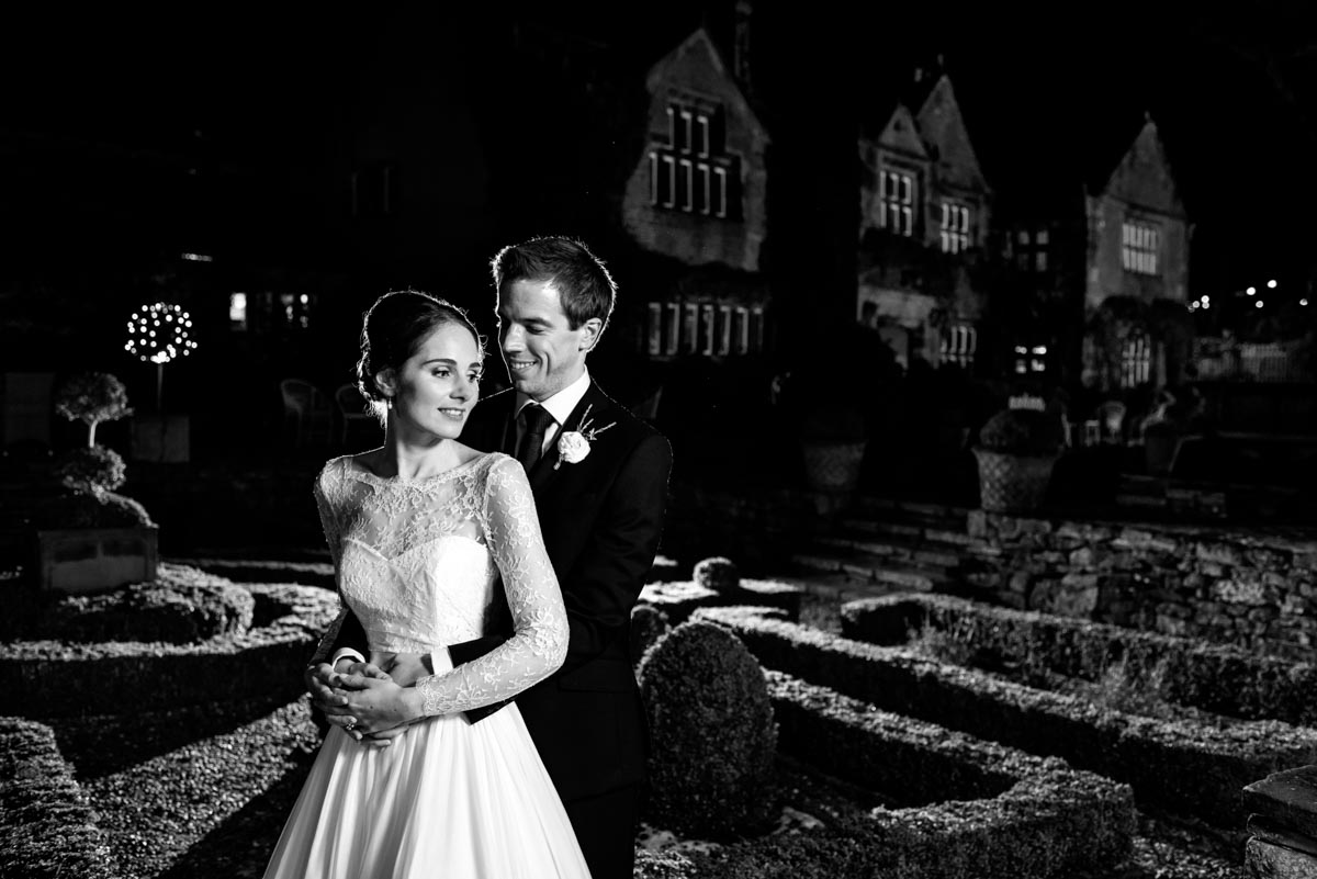 Flash lit portrait of tom and katherine at night on their wedding day at holdsworth house