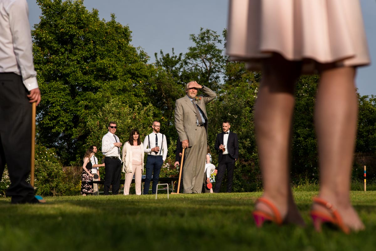 Wedding day game of croquet at Ratsbury Barn