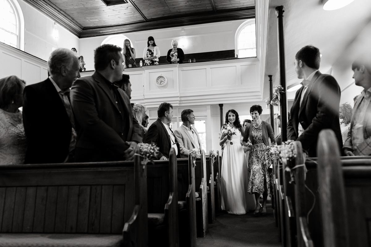 mum escourts daughter into church on her wedding day in Kent