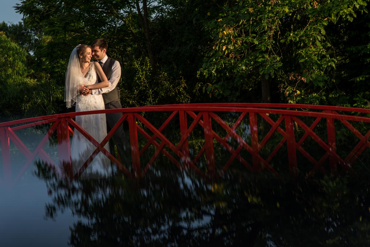 photograph of couple of bridge at ratsbury Barn wedding venue in Kent