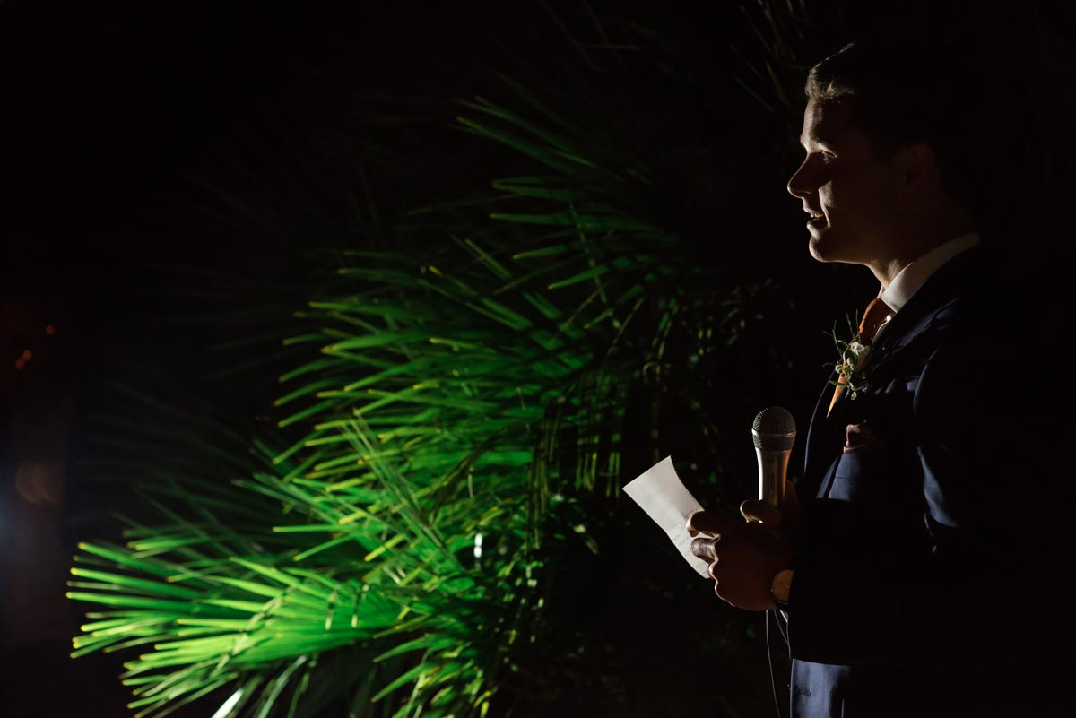 Photograph of groom making his wedding speech in the garden