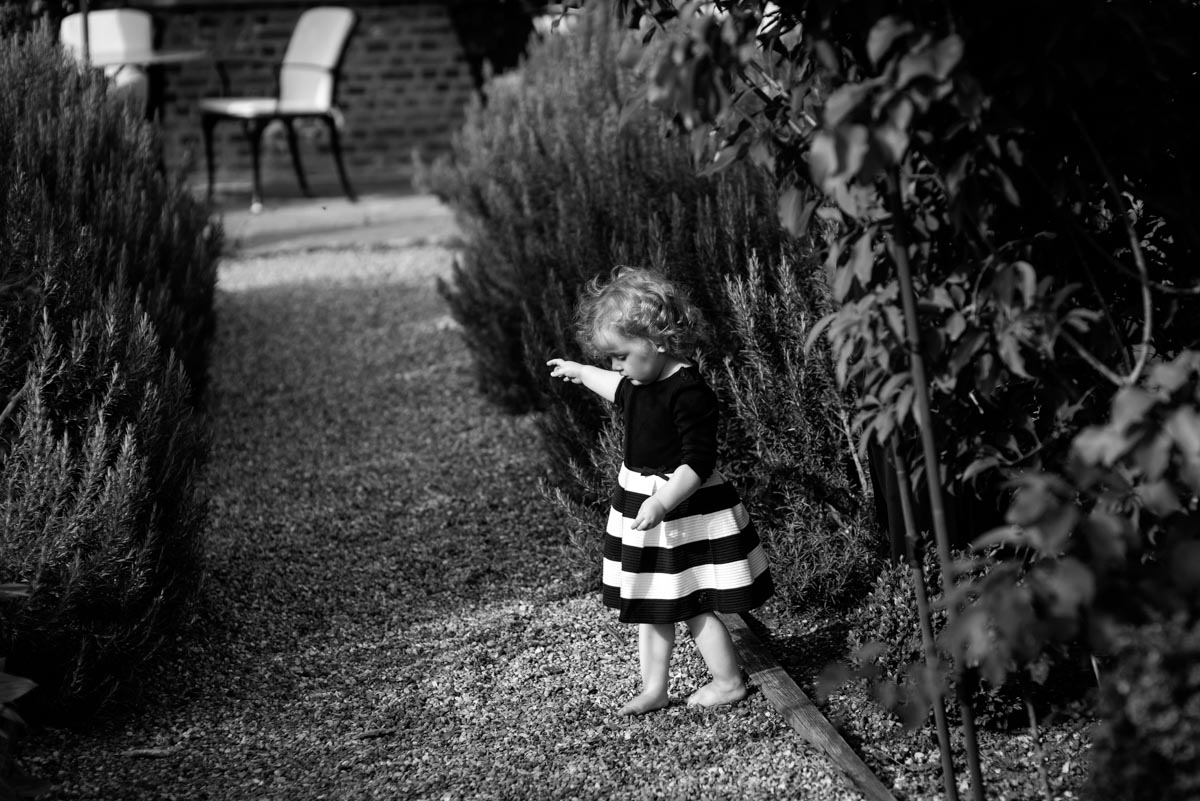 photograph of little girl in stripy skirt at Secret Garden wedding in Kent