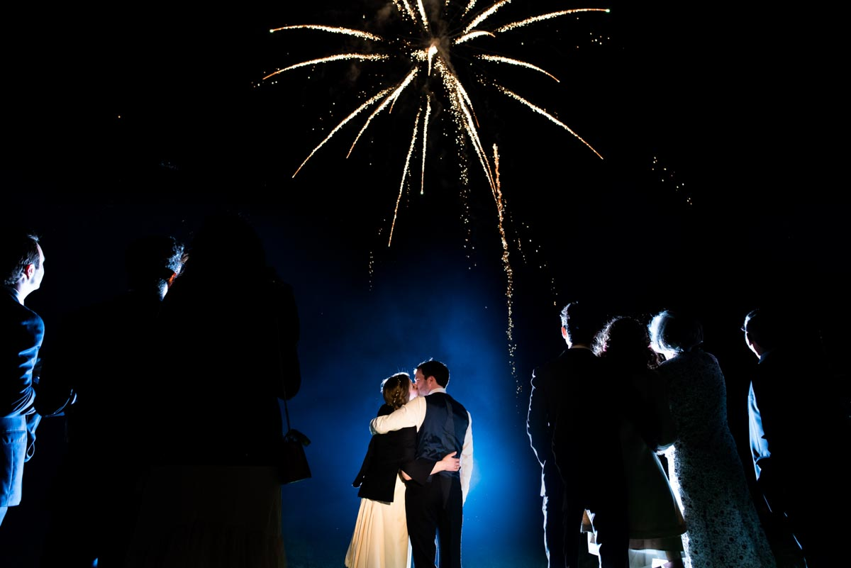 Wedding reception fireworks frame photograph of newly weds