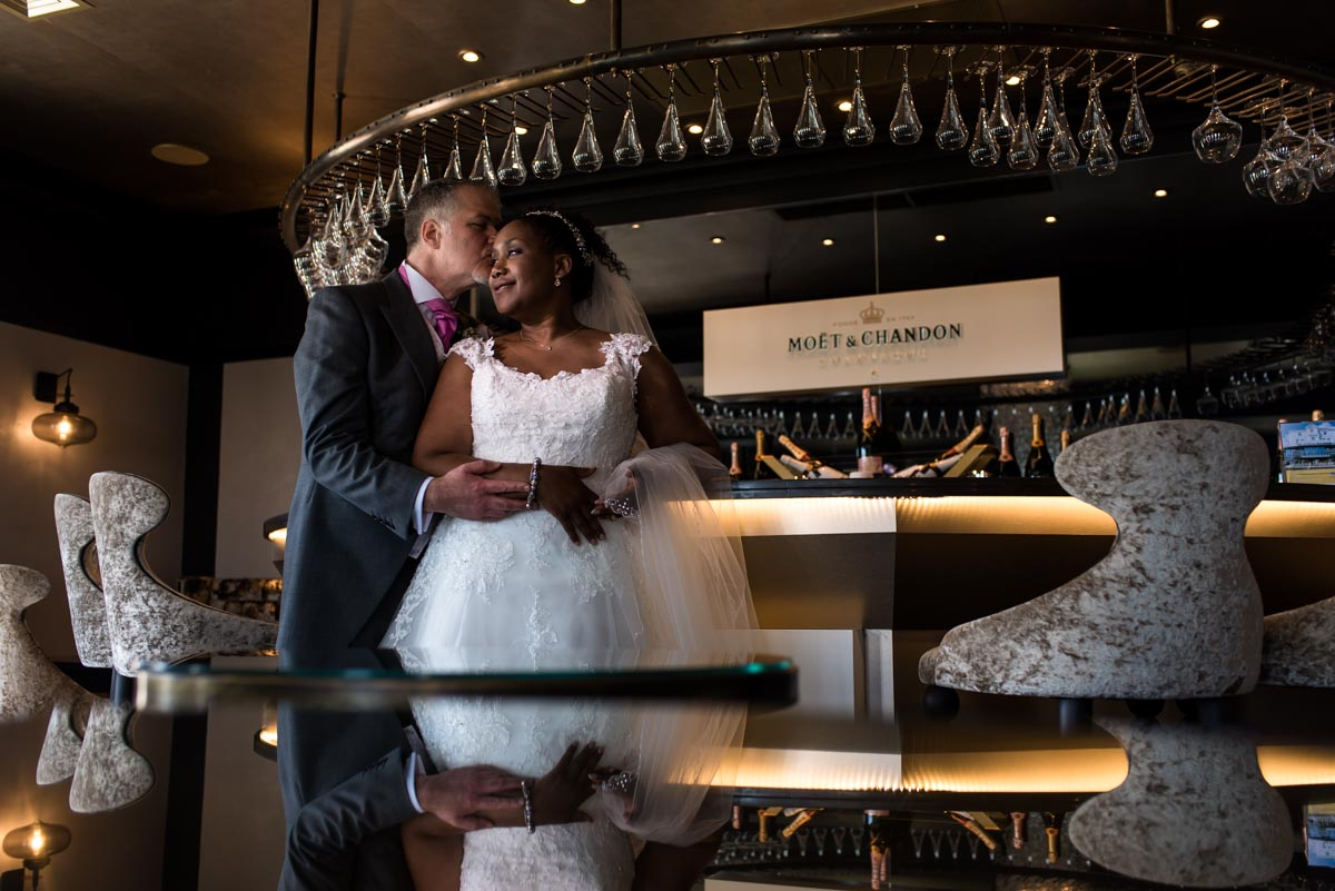Photograph of wedding couple in Hythe Imperial Hotel champagne bar