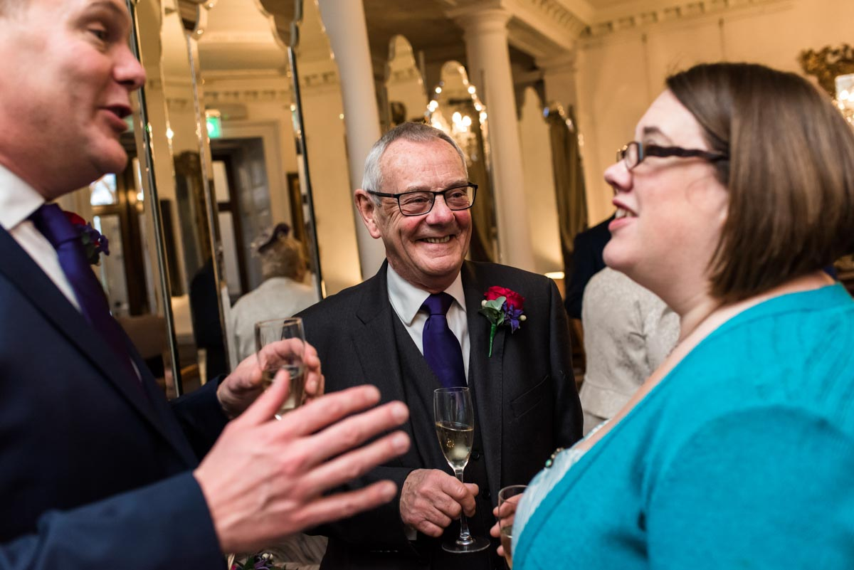 Photograph of Graham talking to wedding guests at chilston park hotel in kent