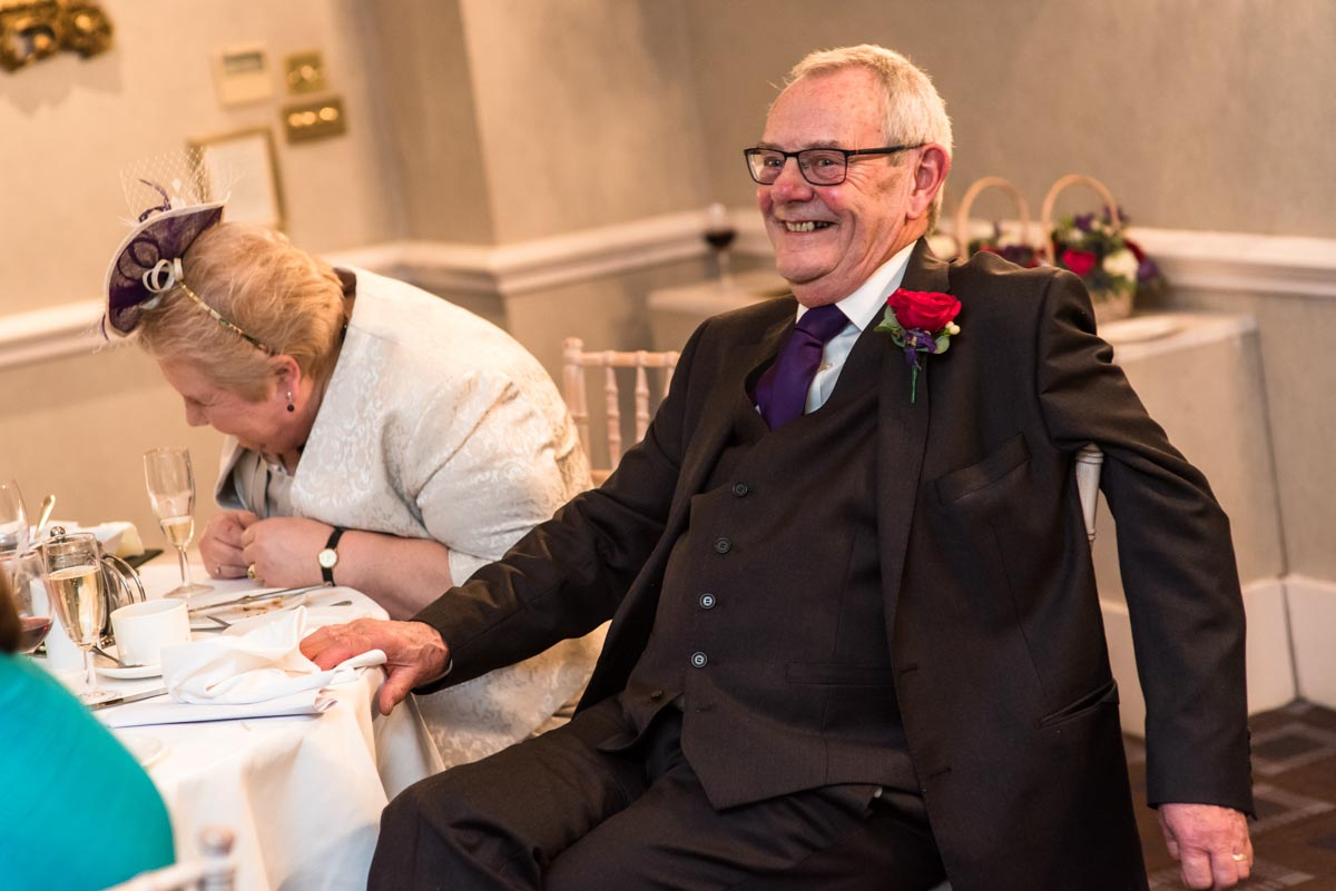 Photograph of Graham laughing during the speeches at his wedding at Chilston park hotel in Kent