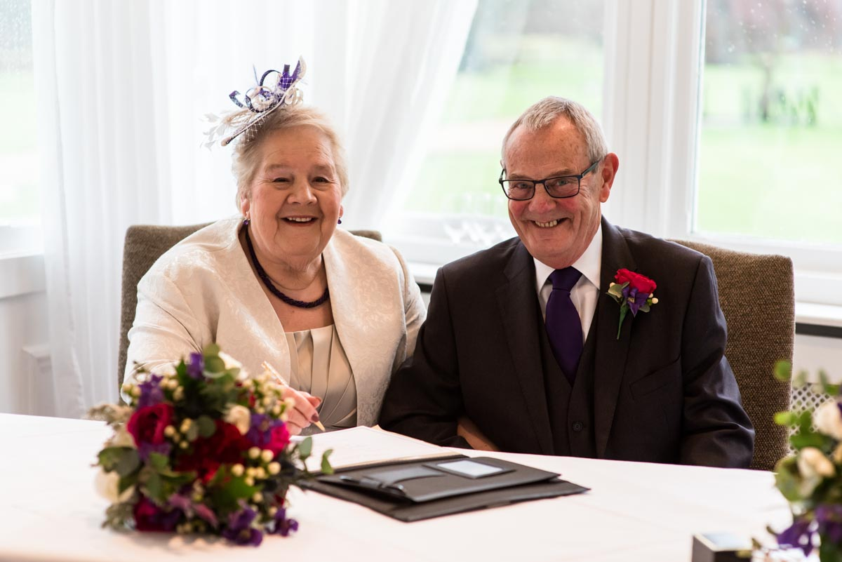 Photograph of Jo and Graham after signing the wedding register at Chiston park in Kent