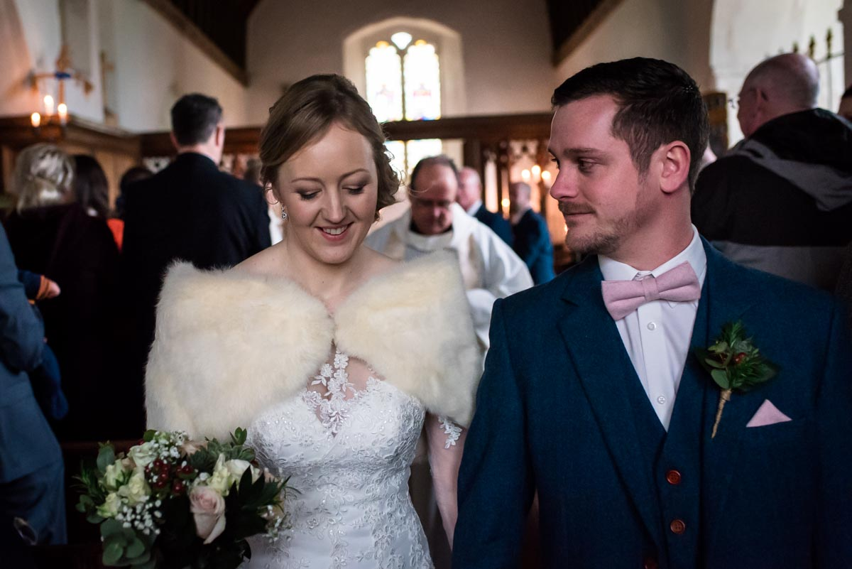 Kent church wedding photography. Stephen and Rebecca leaving after ceremony