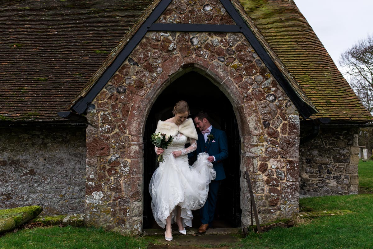 Photograph of Stephen and rebecca at church door after their Kent wedding ceremony
