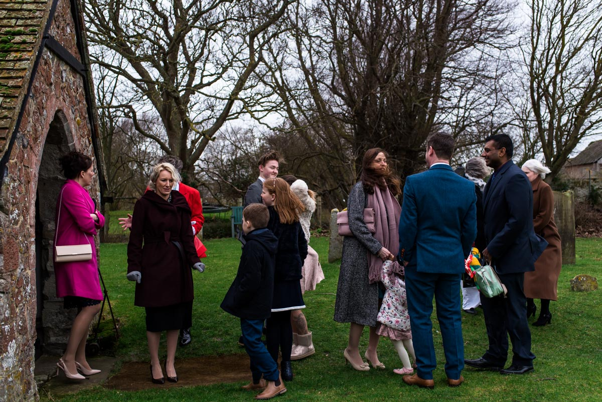 Guests photographed waiting outside Kent church after Rebecca and Stephens ceremony