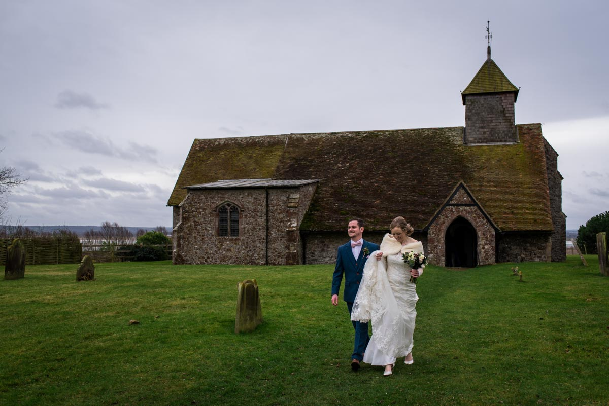 Kent wedding photographer captures bride and groom leaving St Thomas's church after their winter ceremony
