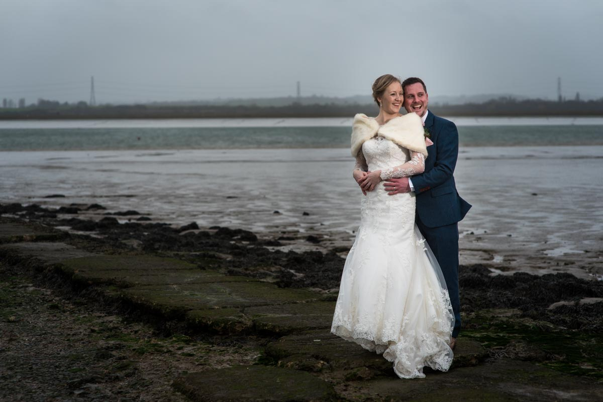 the Ferry House Inn wedding photography. Couple photographs by the estuary.