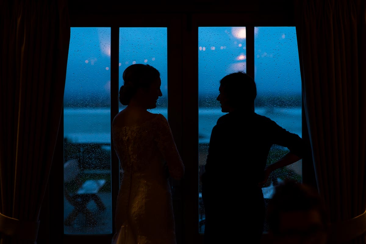 Silhouette photograph of Rebecca and guest at her Ferry house Inn wedding in Kent