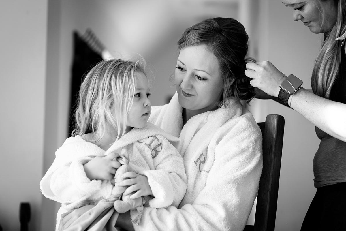 Photograph of Rebecca and her flaoer girl during wedding preparations at Mocketts farm cottages in kent