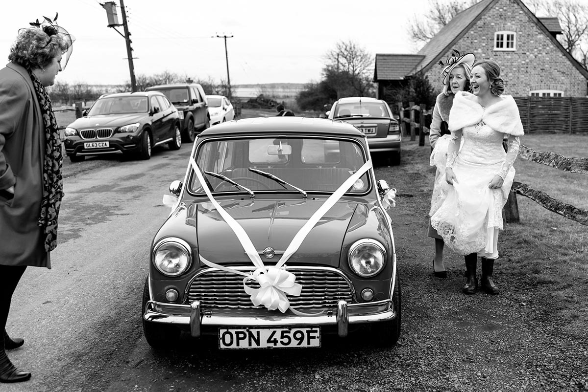 Photograph of bride arriving with mum at Kent church for wedding ceremony