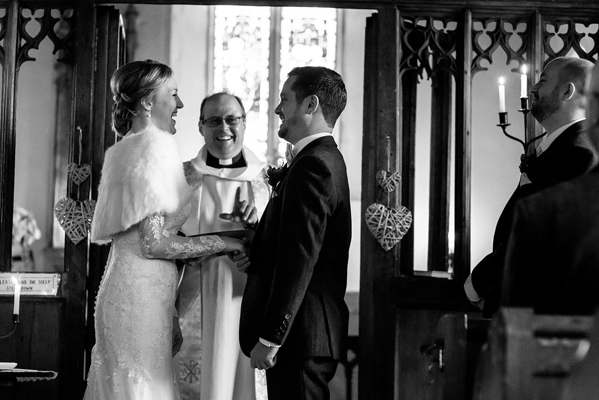 Stephen and Rebecca share a joke during their Kent wedding ceremony